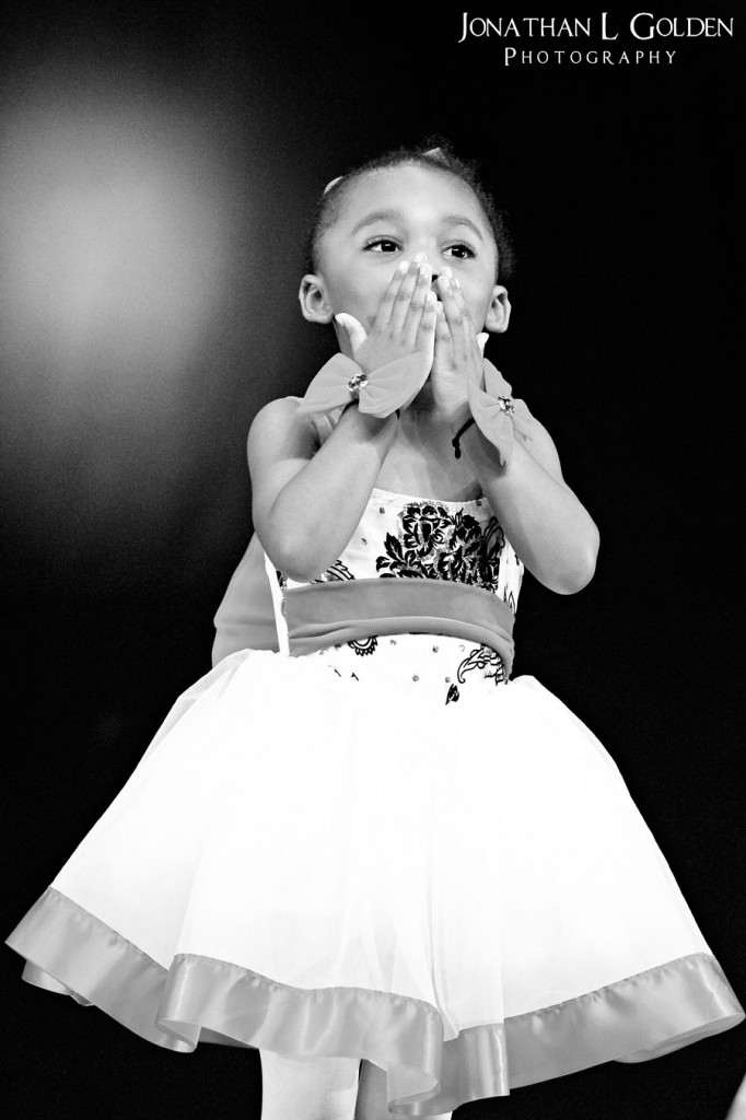 ava-recital-on-stage-blowing-kisses-b&w