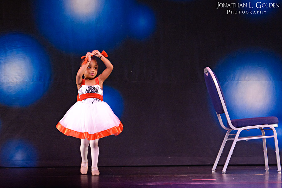 ava-recital-on-stage-point