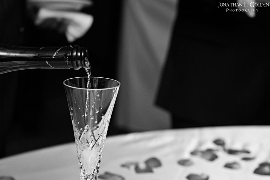 deborah-and-keith-wedding-plaza-club-b&w-pouring-champagne